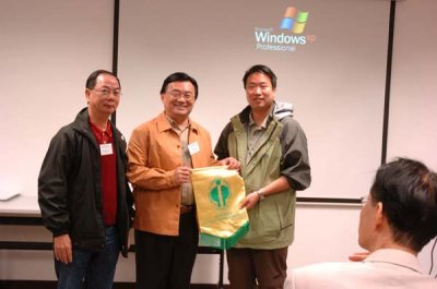 Presentation of souvenir to Wetland Park staff s.jpg