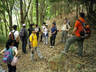 Sunny explaining afforestation to Group.JPG
